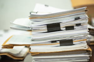 thick-binders-of-work-on-desk