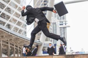 businessman-running-through-city-briefcase