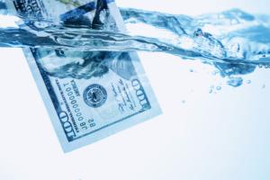 us-100-bill-in-water